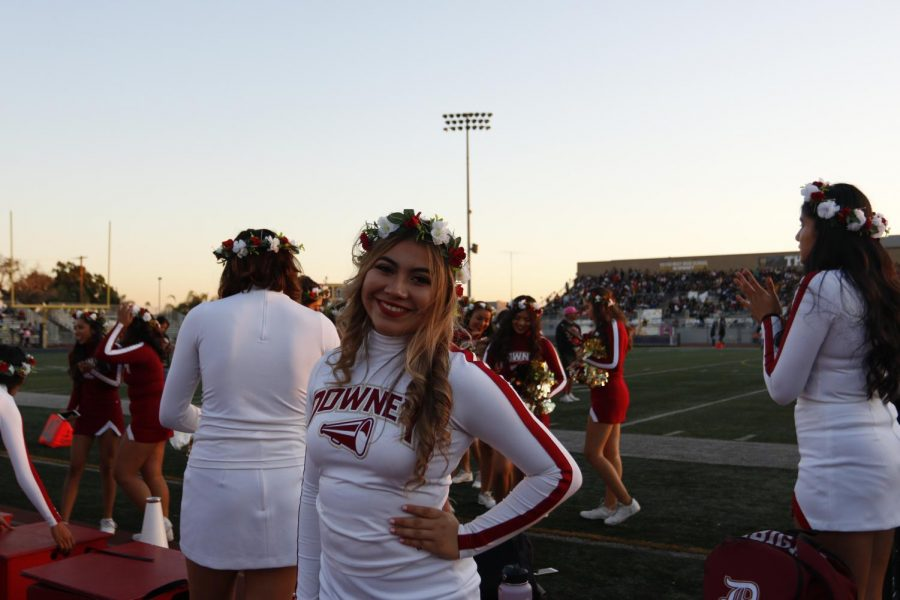 """Performing her last cheers for Downey High, Jazmine Marabilla, 12, pumps up the crowd in a flower crown. """"I'm really sad that it's over,"""" Marabilla said. """"But I'm also really proud of myself for doing this all four years of my high school and for being able to create so many memories with my girls."""""""