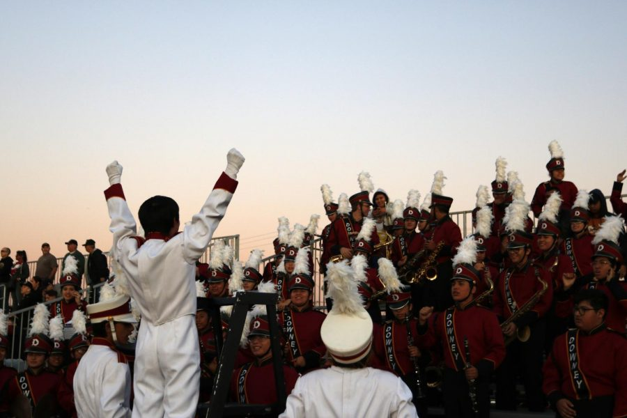 "On his final march, conductor of Downey High's marching band, Matthew Chavez, 12, euphorically leads the band to a night of high spirited clamor. ""When I get up on the stand in front of everyone I feel myself disappear,"" Chavez stated. ""I live in the music and I never fail to receive an electrifying experience, each stronger than the one before."""