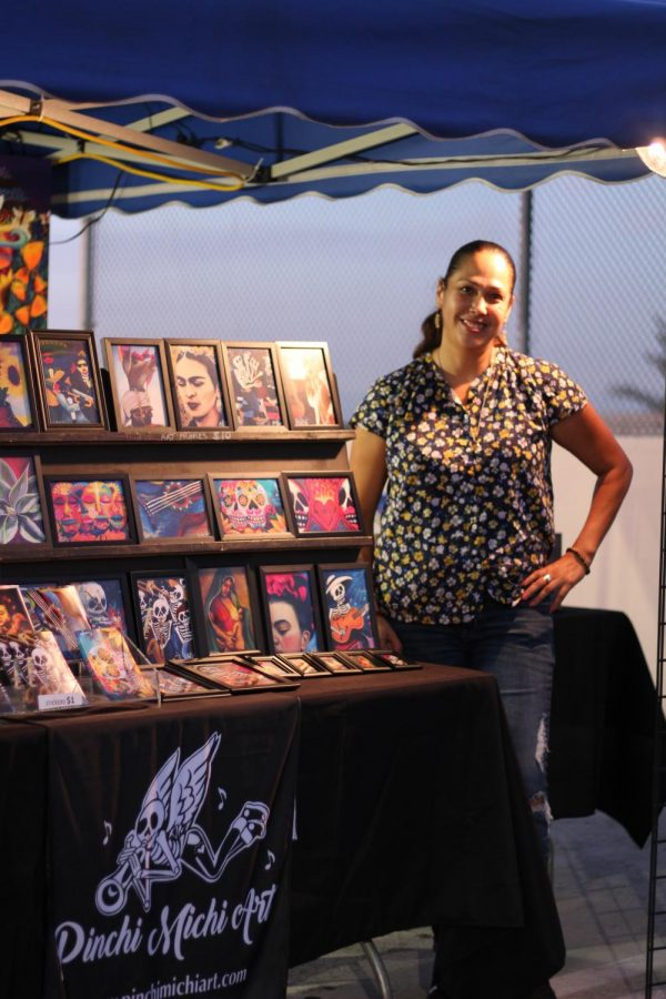 Native Los Angeles Artist, Michelle Taylor, also known as Pinchi Michi, poses with her art pieces awaiting the guests of Havana Nights to pay a visit to her booth.