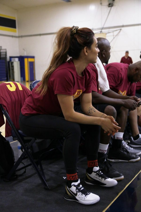 """With high levels of energy playing basketball for the first time, Trina Mendez, strength and conditioning trainer, participated in the Downey staff versus Warren Staff basketball game, giving encouragement to her fellow teammates and quickness on the court to give Downey a win. """"This is a lesson that you always try new things, even if you don't think you will be good at them,'' Mendez states. """"Always challenge yourself, and take courage in trying new things."""""""