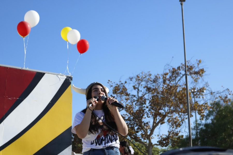 """Her first and final year as Downey High's Commissioner of Viking Nation and Spirit, Senior Viany Campos, hypes up the crowd during Friday's pep rally before the big game. """"It's honestly a bittersweet feeling,"""" Campos said. """"I'm sad that it was my last time, but it was also the best game I've ever experienced; the energy was insane and everyone was so pumped!"""""""