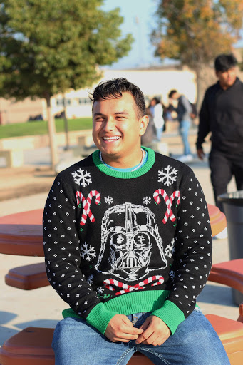 """Enjoying spending time with his family, senior Diego Varela's, favorite thing about Christmas is having a strong liking to Christmas sweaters. """"The warmth and spirit of Christmas they give is amazing, which is why I do not only own one but I have six,"""" Varela stated."""