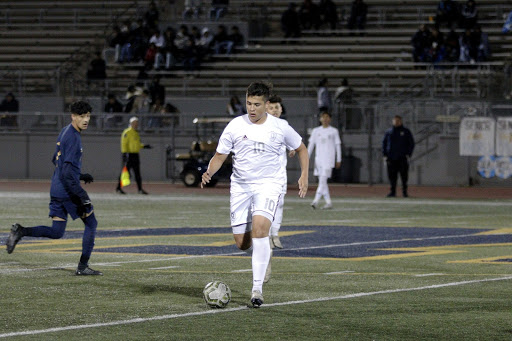 "Downey versus Warren is a bittersweet feeling for David Ruvalcaba, 12, because he has a lot of memories playing against Warren and playing for Downey High. ""I am going to miss playing high school soccer."" Ruvalcaba continues, ""I think I took it for granted a bit and now that time flew by super fast I look back at it and realized these kids went from being total strangers to some of my best friends and we've made some of my favorite memories of high school on the soccer field."""