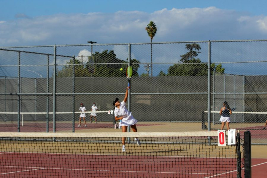 """At the Downey vs. Warren Girls tennis Varsity game on October 15, 2021 on the Downey High School tennis courts, Malinalxochitl Vo, 12, shared her feelings on her team and on the match. """"Its like a family, we're so happy and close together, and we love playing tennis together all the time everyday,"""" Vo stated. """"I feel really confident [in my matches]."""""""